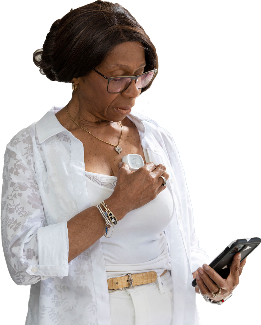 Woman measuring chest ECG with Coala Heart Monitor_Connect Rx